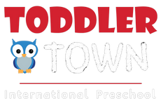 toddler town international preschool logo